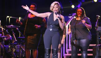 This image released by Starpix shows Mary J. Blige performing at the Shape Magazine and Men's Fitness Super Bowl Party at Cipriani 42nd Street on Friday, Jan. 31, 2014, in New York.  (AP Photo/Starpix, Dave Allocca)