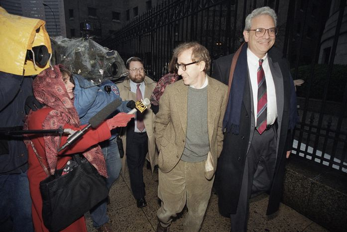 ** FILE ** This Jan. 12, 1993, file photo shows director Woody Allen trading grins with a pursuing television reporter as he arrives at State Supreme Court in Manhattan, New York, for a hearing in which he requested more liberal visitation rights with his children during his ongoing dispute with ex-lover actress Mia Farrow. Dylan Farrow renewed molestation allegations against Allen, Saturday, Feb. 1, 2014, claiming the movie director sexually assaulted her when she was 7 after he and actress Mia Farrow adopted her. (AP Photo/Mario Cabrera, File)
