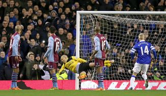 Players turn to watch Aston Villa goalkeeper Bradley Guzan, center, fail to stop Everton's Kevin Mirallas, not pictured, from scoring their second goal of the game during their English Premier League soccer match at Goodison Park, Liverpool, England, Saturday, Feb. 1, 2014. (AP Photo/Peter Byrne, PA Wire)   UNITED KINGDOM OUT  -  NO SALES   -  NO ARCHIVES