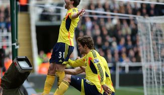 Sunderland's Fabio Borini, left, celebrates his goal during their English Premier League soccer match against Newcastle United at St James' Park, Newcastle, England, Saturday, Feb. 1, 2014. (AP Photo/Scott Heppell)