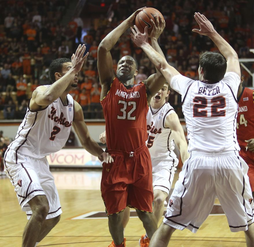 Maryland's Dez Wells (32) drives through the defense of Virginia Tech's Joey van Zegeren (2) Will Johnston ( 25) and Christian Beyer (22)  during the first half of an NCAA college basketball game in Blacksburg, Va., Saturday, Feb. 1 2014. (AP Photo/The Roanoke Times, Matt Gentry) LOCAL TV OUT; SALEM TIMES REGISTER OUT; FINCASTLE HERALD OUT;  CHRISTIANBURG NEWS MESSENGER OUT; RADFORD NEWS JOURNAL OUT; ROANOKE STAR SENTINEL OUT