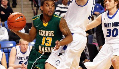 George Mason's Corey Edwards (13) works the baseline as Saint Louis' Rob Loe (51) defends during the first half of an NCAA college basketball game Saturday, Feb. 1, 2014, in St. Louis. (AP Photo/Scott Kane)