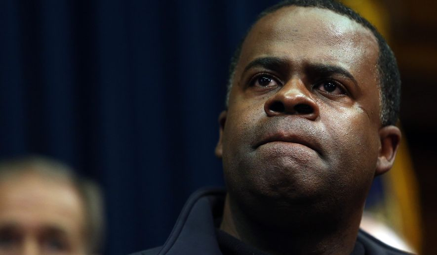 This Jan. 29, 2014 file photo, Atlanta Mayor Kasim Reed listens to a question about the city's response to the snow storm during a news conference in the Governor's office at the State Capitol in Atlanta. (AP Photo/Atlanta Journal-Constitution, Ben Gray)