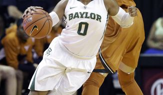 Baylor guard Odyssey Sims (0) drives around Texas center Kelsey Lang (40) during the first half of an NCAA college basketball game, Saturday, Feb. 1, 2014, in Waco, Texas. (AP Photo/LM Otero)