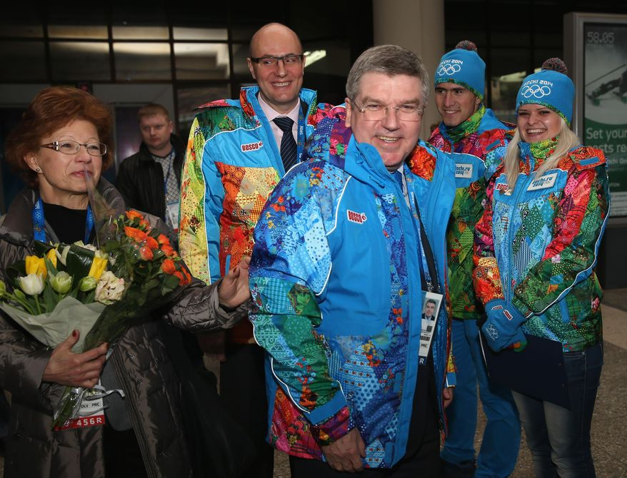 International Olympic Committee President Thomas Bach, center right, arrives at Sochi International Airport prior to the Sochi 2014 Winter Olympics on Friday, Jan. 31, 2014 in Sochi, Russia. The Olympic games will run from Feb. 7-23. (AP Photo/Matthew Stockman, Pool)