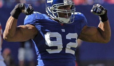FILE - In this Oct. 8, 2006, file photo, New York Giants defensive end Michael Strahan reacts after sacking Washington Redskins quarterback Mark Brunell during second quarter NFL football at Giants Stadium in East Rutherford, N.J. Strahan was elected to the Pro Football Hall of Fame on Saturday, Feb. 1, 2014. (AP Photo/Bill Kostroun)