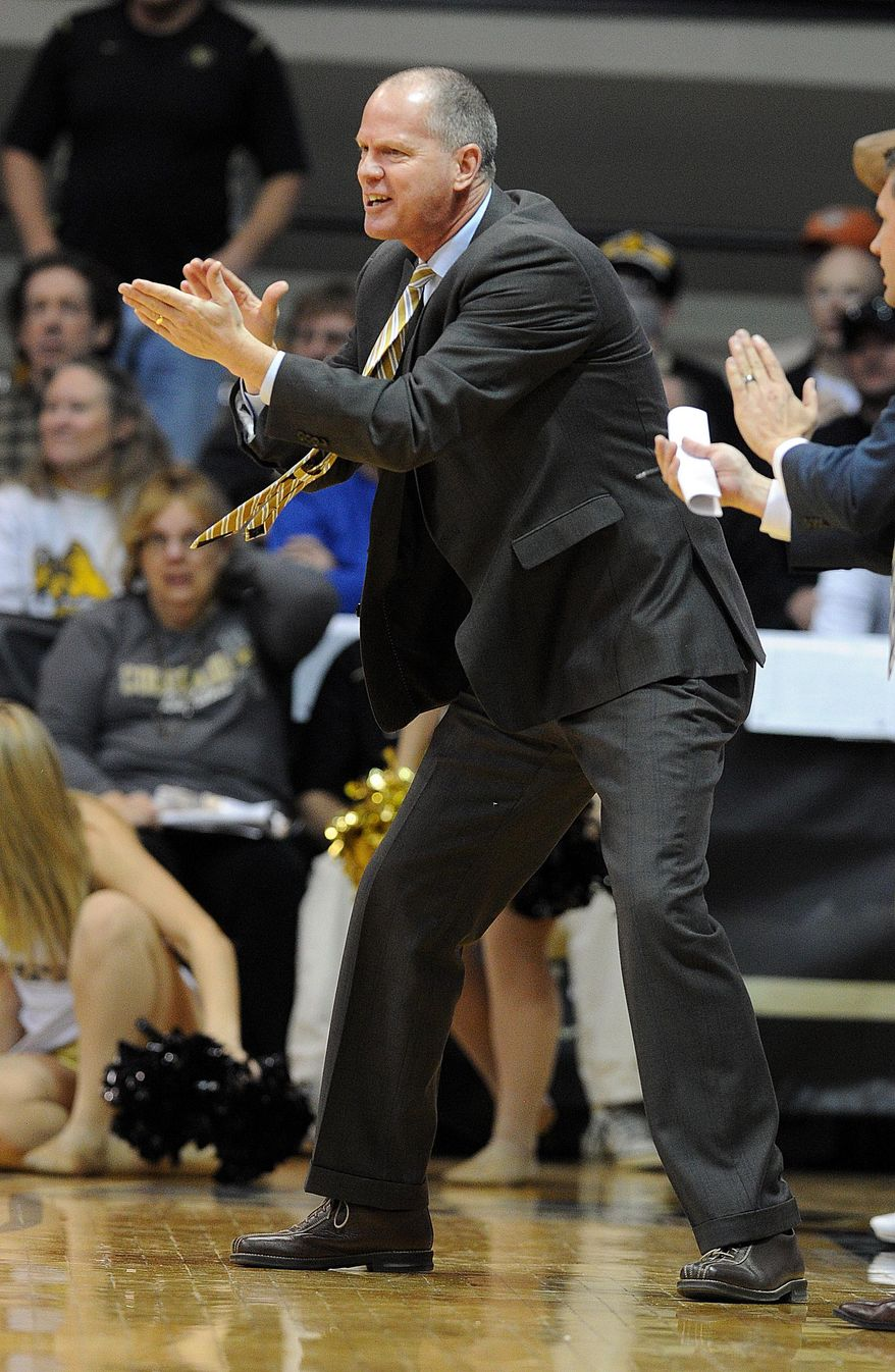 Colorado head coach, Tad Boyle tries to get his team going during the first half of an NCAA college basketball game againt Utah Saturday, Feb. 1, 2014, in Boulder, Colo. (AP Photo/The Daily Camera, Cliff Grassmick) NO SALES