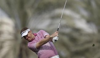 Stephen Gallacher from Scotland plays a ball on the 14th hole during the third round of the Dubai Desert Classic golf tournament in Dubai, United Arab Emirates, Saturday Feb.1, 2014. (AP Photo/Kamran Jebreili)