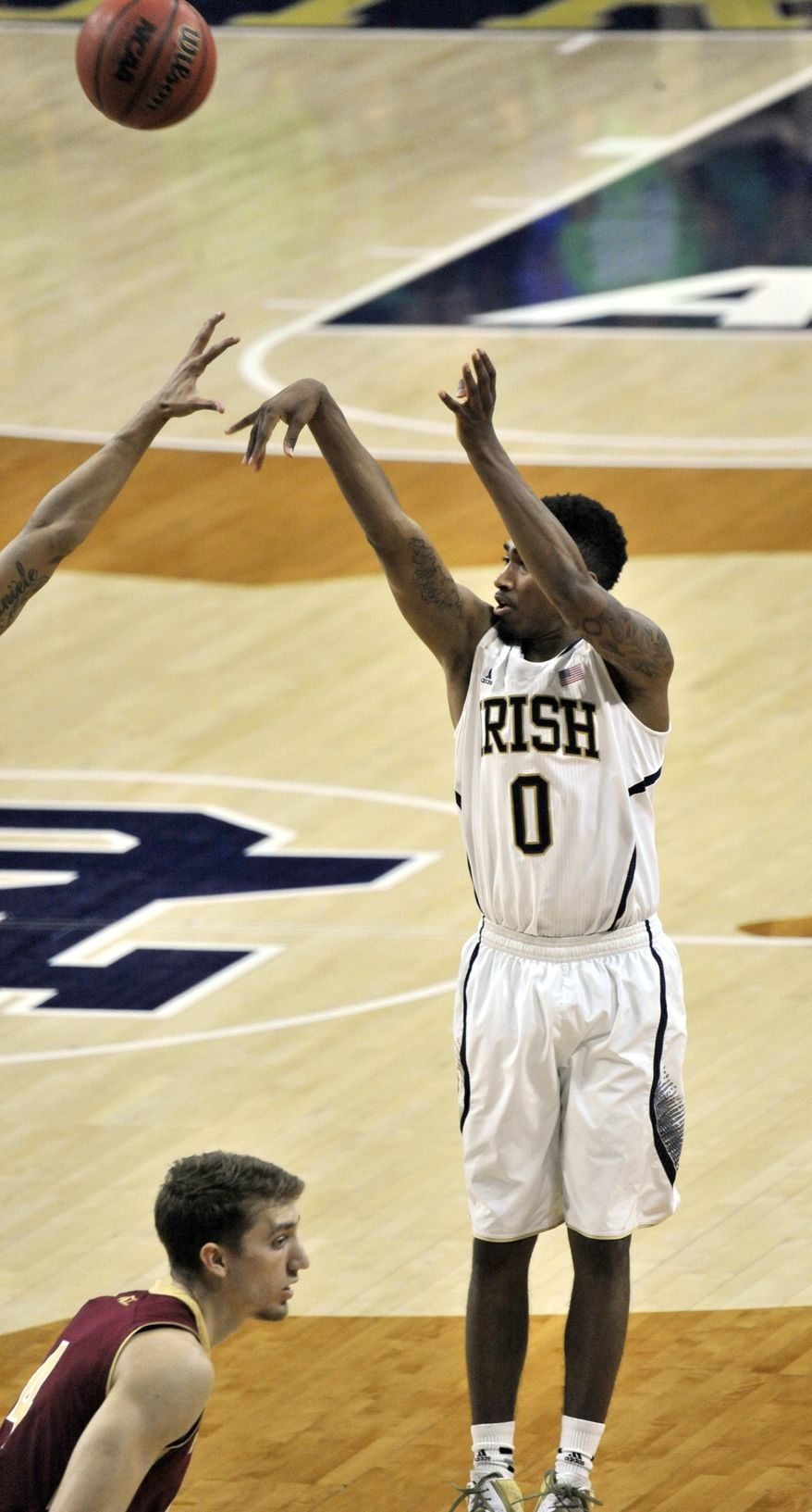 Notre Dame guard Eric Atkins puts up the game-winning shot in overtime of an NCAA college basketball game against Boston College, Saturday, Feb. 1 2014 in South Bend, Ind. Notre Dame won 76-73, with Atkins leading all scorers with 24 points. (AP Photo/Joe Raymond)