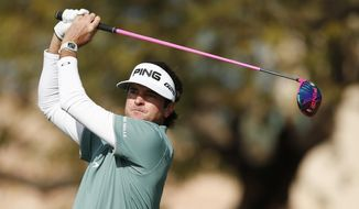 Bubba Watson hits a tee shot at the second hole during the third round of the Phoenix Open golf tournament, Saturday, Feb. 1, 2014, in Scottsdale, Ariz. (AP Photo/Ross D. Franklin)
