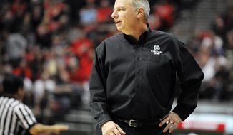 Colorado State's head coach Larry Eustachy looks on during the first half of an NCAA college basketball game against San Diego State on Saturday, Feb. 1, 2014, in San Diego.  (AP Photo/Denis Poroy)