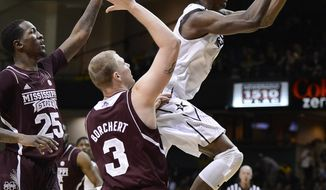 Vanderbilt forward Rod Odom, right, drives past Mississippi State forwards Roquez Johnson (25) and Colin Borchert (3) during the first half of an NCAA college basketball game Saturday, Feb. 1, 2014, in Nashville, Tenn. (AP Photo/Mark Zaleski)