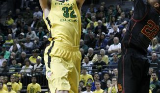 Oregon's Ben Carter, left, goes up for a basket against Southern California's Byron Wesley during the first half of an NCAA college basketball game in Eugene, Ore. on Saturday, Feb. 1, 2014. (AP Photo/Chris Pietsch)
