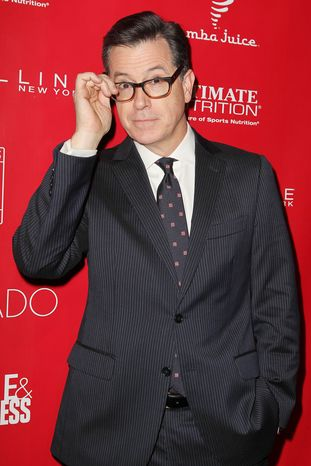 This image released by Starpix shows Stephen Colbert at the Shape Magazine and Men's Fitness Super Bowl Party at Cipriani 42nd Street on Friday, Jan. 31, 2014, in New York.  (AP Photo/Starpix, Amanda Schwab)