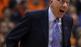 Syracuse head coach Jim Boeheim reacts to a play late in the second half of an NCAA college basketball game against Duke in Syracuse, N.Y., Saturday, Feb. 1, 2014. Syracuse won 91-89. (AP Photo/Nick Lisi)