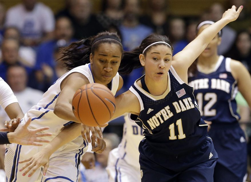 Notre Dame's Natalie Achonwa (11) and Duke's Oderah Chidom chase the ball during the first half of an NCAA college basketball game in Durham, N.C., Sunday, Feb. 2, 2014. (AP Photo/Gerry Broome)