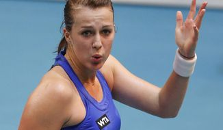 Anastasia Pavlyuchenkova of Russia reacts after losing a point against to Sara Errani of Italy during the final match of the 22st Gaz de France WTA Open 2014 tennis tournament at Coubertin stadium, in Paris, Sunday Feb. 2, 2014. (AP Photo/Jacques Brinon)