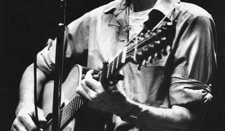 File- This Feb. 25, 1984, file photo shows folk singer Pete Seeger  performing in a one-man benefit concert in Berkeley, Calif., at the Berkeley Community Theater. Hundreds of friends and fans joined in song Sunday, Feb. 2, 2014, to honor Seeger, doing what the folk singer loved best. Seeger died Jan. 27 at age 94; no services were planned.  (AP Photo/Mark Costantini, File)