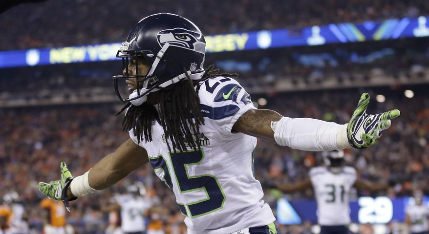 Seattle Seahawks' Richard Sherman (25) reacts during the second half of the NFL Super Bowl XLVIII football game against the Denver Broncos Sunday, Feb. 2, 2014, in East Rutherford, N.J. (AP Photo/Jeff Roberson)