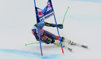Ted Ligety of the Unites States speeds down the course during the first run of an alpine ski men's World Cup giant slalom in St. Moritz, , Switzerland, Sunday, Feb. 2, 2014. (AP Photo/Pier Marco Tacca)