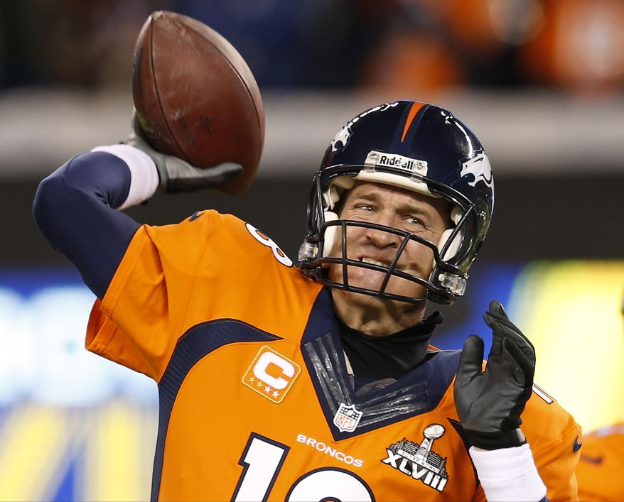Denver Broncos quarterback Peyton Manning warms up on the field before the NFL Super Bowl XLVIII football game against the Seattle Seahawks Sunday, Feb. 2, 2014, in East Rutherford, N.J. (AP Photo/Evan Vucci)