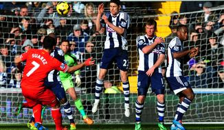 West Bromich Albion defenders try to block the free kick from Liverpool's Luis Suarez's during their English Premier League soccer match at The Hawthorns stadium in West Bromwich, England, Sunday, Feb. 2, 2014. (AP Photo/Rui Vieira)