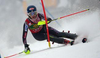 Mikaela Shiffrin of the Unites States competes during the first run of a alpine women's Worlsd Cup Slalom in Kranjska Gora, Slovenia, Sunday, Feb. 2, 2014. (AP Photo/Giovanni Auletta)