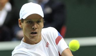 Tomas Berdych from the Czech Republic returns to Thiemo De Bakker from the Netherlands during their Davis Cup first round singles match in Ostrava, Czech Republic, Sunday, Feb. 2, 2014.  Berdych won  6-1, 6-4, 6-3. (AP Photo,CTK/Jaroslav Ozana) SLOVAKIA OUT