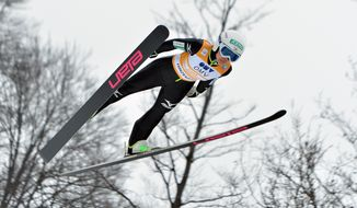 Japan's Sara Takanashi soars through the air  during the competition jump  of the Ski Jumping World Cup Ladies event in  Hinzenbach, Austria, on Sunday, Feb. 2. 2014. (AP Photo/Kerstin Joensson)