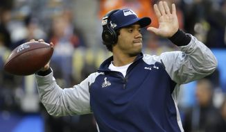 Seattle Seahawks quarterback Russell Wilson warms up before the NFL Super Bowl XLVIII football game against the Denver Broncos Sunday, Feb. 2, 2014, in East Rutherford, N.J. (AP Photo/Matt Slocum)