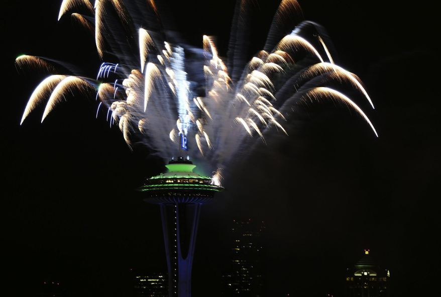 Celebratory fireworks are set off behind The Space Needle in Seattle, after the Seahawks won the Super Bowl for the first time in history on Sunday, Feb. 2, 2014. The Seahawks, in their second Super Bowl appearance ever,  won 43-8 over the Denver Broncos at MetLife Stadium in New Jersey.  (AP Photo/The Seattle Times, Lindsey Wasson)