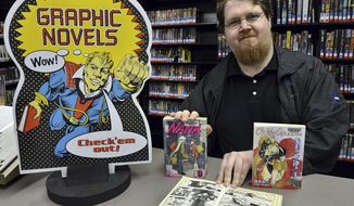 """ADVANCE FOR MONDAY FEB. 3 AND THEREAFTER This Thursday Jan. 16, 2014 photo shows Nicholas Anderson the winner of the Saint. Albans Library's challenge to read 150 books at the library in Saint. Albans, W.Va.  Nicholas, 30, read 450 books within the last year.  He likes """"graphic novels"""" and compares the art in them to comic books.   (AP Photo/Charleston Daily Mail, Craig Cunningham)"""