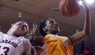Tennessee's Bashaara Graves (12) pulls in a rebound over Alabama's Nikki Hegstetter (13) during the first half of an NCAA college basketball game, Sunday, Feb. 2, 2014, in Tuscaloosa, Ala. (AP Photo/Butch Dill)
