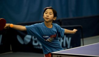 Tiffany Ke, 9, of Potomac, Md.,  competes during the Roanoke Table Tennis Open at Sun Tennis Center in Roanoke, Va.  She was playing singles against Madhu Diwakar, 25, of Charlotte.  She ranks in the top 21 nationally for under 10 years old.   Ke plays against players who are older and more experienced than she is, but, the game depends more on a keen hand-eye coordination than strength or strategy, organizers of the weekend's tournament said. (AP Photo/The Roanoke Times, Stephanie Klein-Davis)  LOCAL TV OUT; SALEM TIMES REGISTER OUT; FINCASTLE HERALD OUT;  CHRISTIANBURG NEWS MESSENGER OUT; RADFORD NEWS JOURNAL OUT; ROANOKE STAR SENTINEL OUT