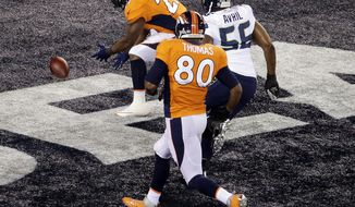 Denver Broncos' Knowshon Moreno (27) recovers the football in the end zone for a safety as Seattle Seahawks' Heath Farwell (55) and teammate Julius Thomas (80) chase him during the first half of the NFL Super Bowl XLVIII football game Sunday, Feb. 2, 2014, in East Rutherford, N.J. (AP Photo/Charlie Riedel)