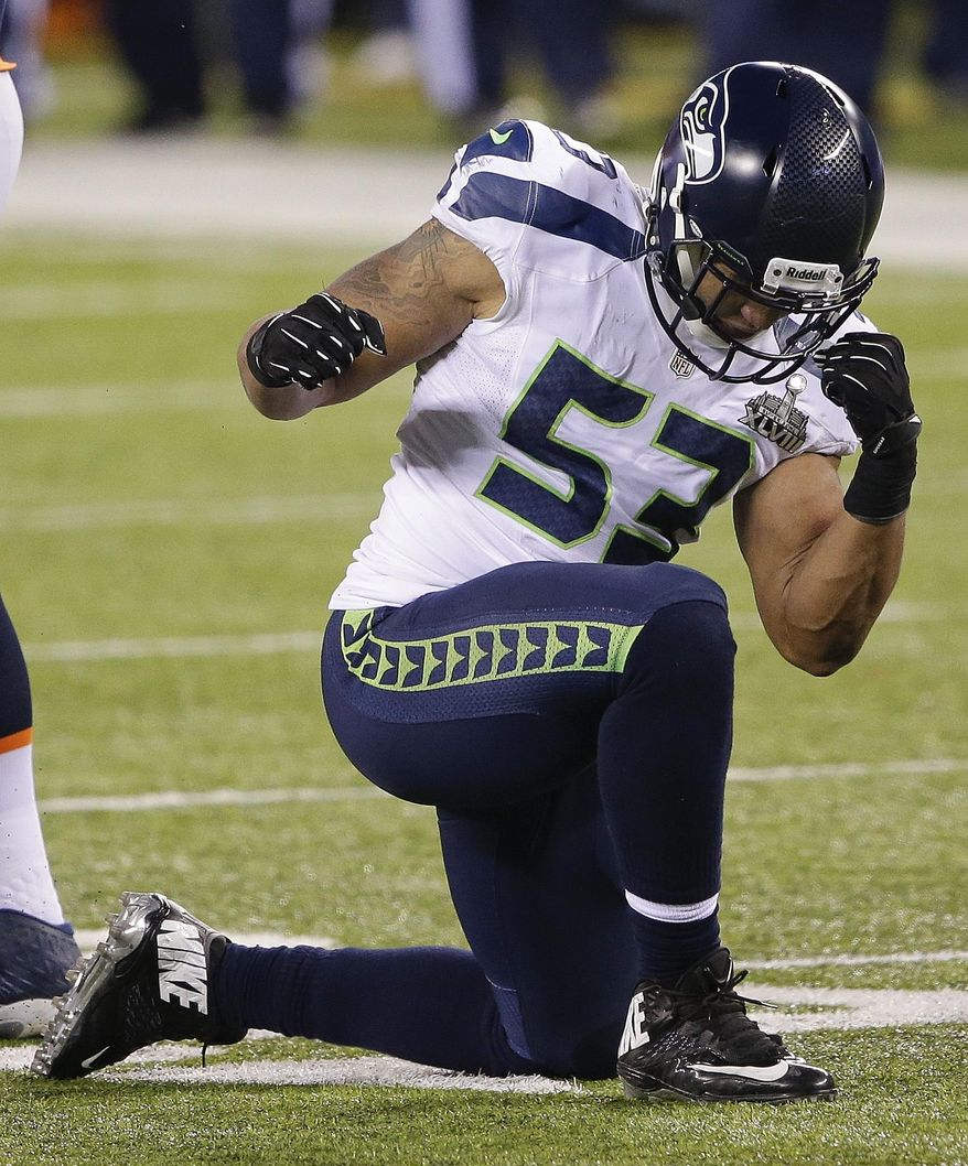 Seattle Seahawks outside linebacker Malcolm Smith (53) reacts after making a tackle against the Denver Broncos during the second half of the NFL Super Bowl XLVIII football game, Sunday, Feb. 2, 2014, in East Rutherford, N.J. (AP Photo/Gregory Bull)