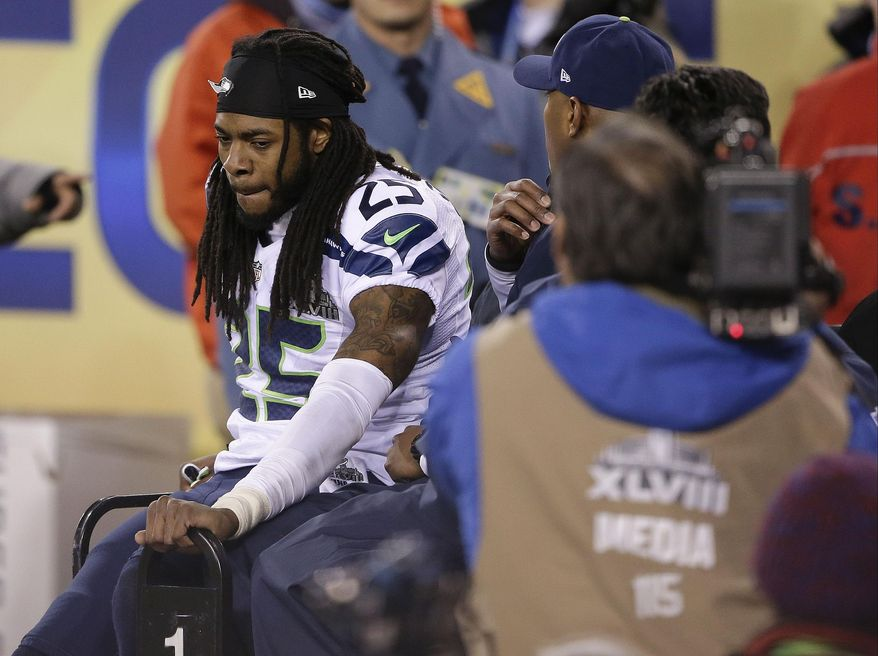 Seattle Seahawks cornerback Richard Sherman (25) leaves the field after being injured during the second half of the NFL Super Bowl XLVIII football game against the Denver Broncos Sunday, Feb. 2, 2014, in East Rutherford, N.J. (AP Photo/Gregory Bull)