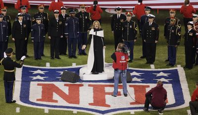 Opera singer Renée Fleming sings the national anthem before the NFL Super Bowl XLVIII football game between the Seattle Seahawks and the Denver Broncos Sunday, Feb. 2, 2014, in East Rutherford, N.J. (AP Photo/Charlie Riedel)