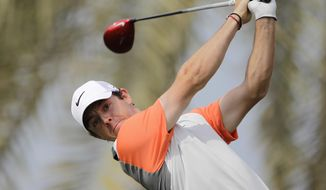 Rory McIlroy of Northern Ireland plays a shot off the 3rd tee during the final round of the Dubai Desert Classic golf tournament in Dubai, United Arab Emirates, Sunday Feb. 2, 2014. (AP Photo/Kamran Jebreili)
