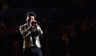 Bruno Mars performs during the halftime show of the NFL Super Bowl XLVIII football game between the Seattle Seahawks and the Denver Broncos Sunday, Feb. 2, 2014, in East Rutherford, N.J. (AP Photo/Bill Kostroun)