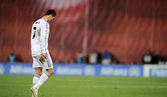 Real Madrid's Cristiano Ronaldo of Portugal, leaves the pitch after receiving a direct red card, during their Spanish League soccer match against Athletic Bilbao, at San Mames stadium in Bilbao, Spain, Sunday, Feb. 2, 2014.  (AP Photo/Alvaro Barrientos)