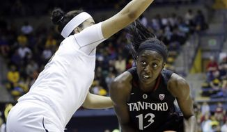 Stanford forward Chiney Ogwumike (13) tries to get around California forward Justine Hartman during the first half on an NCAA college basketball game, Sunday, Feb. 2, 2014, in Berkeley, Calif. (AP Photo/Marcio Jose Sanchez)