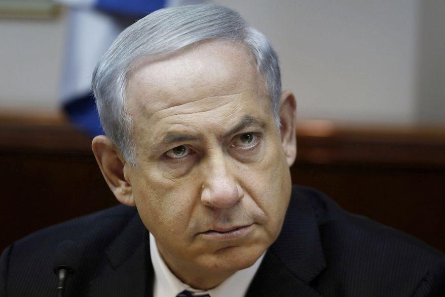 Israel's Prime Minister Benjamin Netanyahu chairs the weekly cabinet meeting in Jerusalem, Sunday, Feb. 2, 2014. (AP Photo/Gali Tibbon, Pool)