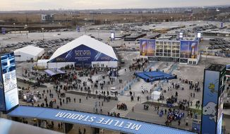 Fans walk near the MetLife Stadium before the NFL Super Bowl XLVIII football game between the Seattle Seahawks and the Denver Broncos Sunday, Feb. 2, 2014, in East Rutherford, N.J. (AP Photo/Seth Wenig)