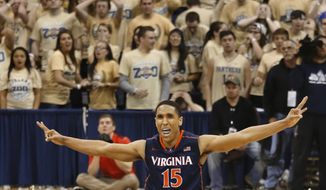 Virginia's Malcolm Brogdon celebrates after hitting a 3-point basket in the second half of an NCAA college basketball game against Pittsburgh, Sunday, Feb. 2, 2014, in Pittsburgh. Virginia won 48-45. (AP Photo/Keith Srakocic)