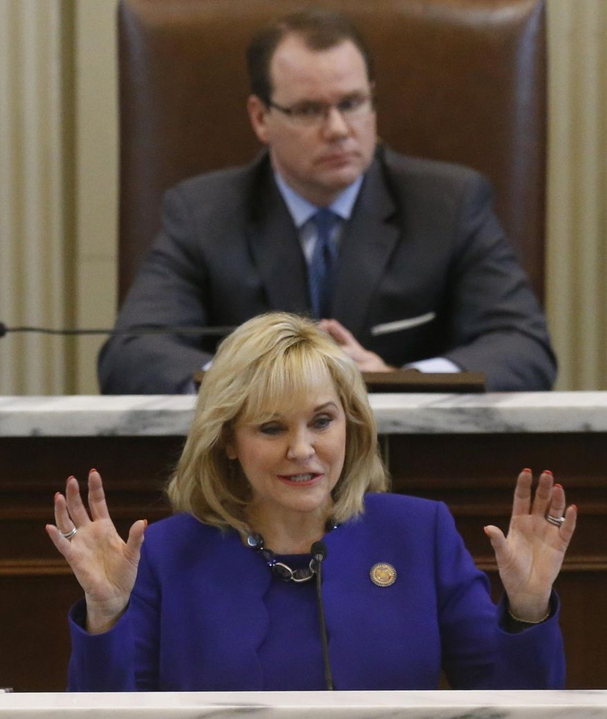 Oklahoma Governor Mary Fallin gestures as she gives her State of the State address in Oklahoma City, Monday, Feb. 3, 2014. Behind her is Lt. Governor Todd Lamb. (AP Photo/Sue Ogrocki)