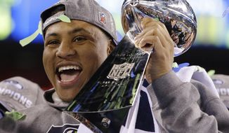 Seattle Seahawks' Malcolm Smith holds the Vince Lombardi Trophy after the NFL Super Bowl XLVIII football game against the Denver Broncos Sunday, Feb. 2, 2014, in East Rutherford, N.J. The Seahawks won 43-8. (AP Photo/Matt Slocum)