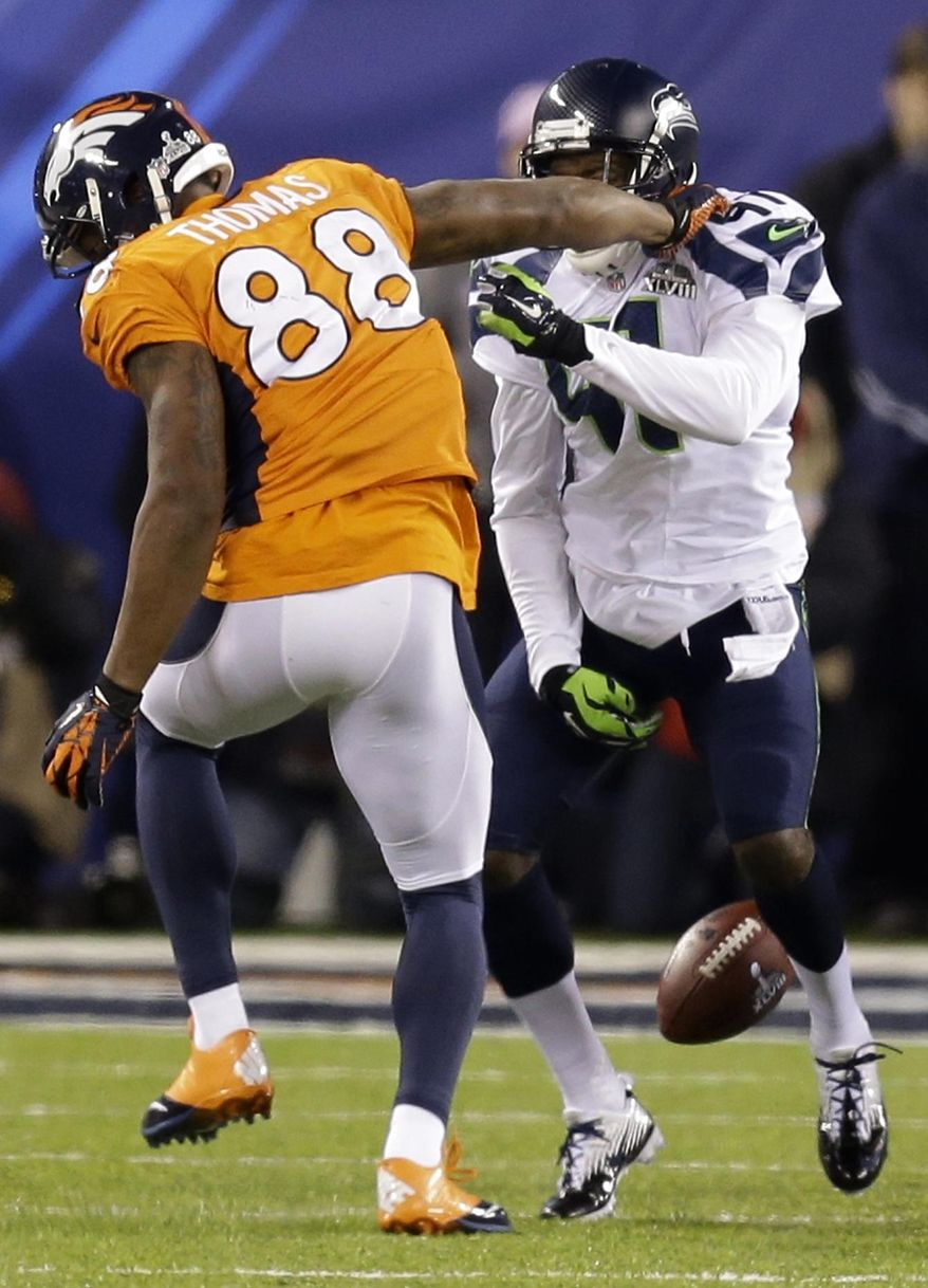 Denver Broncos' Demaryius Thomas, left, fumbles the ball as he his hit by Seattle Seahawks' Byron Maxwell during the second half of the NFL Super Bowl XLVIII football game Sunday, Feb. 2, 2014, in East Rutherford, N.J. (AP Photo/Ben Margot)