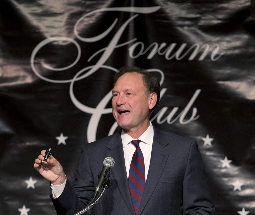 U.S. Supreme Court Justice Samuel Alito holds up a figurine of himself that someone gave him, as he speaks, Monday, Feb. 3, 2014 to a joint meeting of the Forum Club of the Palm Beaches and the Palm Beach County Bar Association at the Palm Beach County Convention Center in West Palm Beach, Fla. Alito said the high court should never worry about its popularity when deciding cases.  Alito told an audience of more than 1,100 people that the nine justices would undermine the court's standing if they were concerned about public opinion. (AP Photo/Wilfredo Lee)