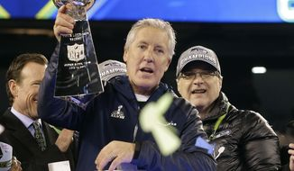 Seattle Seahawks head coach Pete Carroll celebrates with the Vince Lombardi Trophy after the NFL Super Bowl XLVIII football game against the Denver Broncos Sunday, Feb. 2, 2014, in East Rutherford, N.J. The Seahawks won 43-8. (AP Photo/Ted S. Warren)
